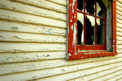 Broken Window. An Old House with peeling paint and a broken window royalty free stock image
