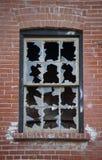 Broken window. A Broken windows of an old house Stock Images