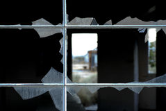 Broken Window. A broken window abstract taken in an abandoned town in California. The camera used was a Nikon D200 with a 60mm micro lens set at 1/50 sec at f/4 Royalty Free Stock Photos