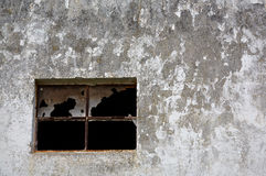 Broken window. A view of a broken window on an old wall Stock Photography