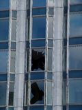 Broken window. A broken window in an office building Stock Photos