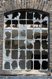 Broken window. In a disused railway station royalty free stock photography