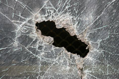 Broken window. Of armoured glass. Bulletproof glass hole stock photo