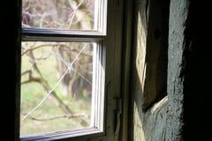 Broken Window. In an very old Room Stock Photos