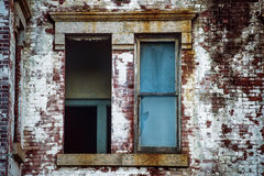 Broken window in abandoned expensive brick house Royalty Free Stock Photography