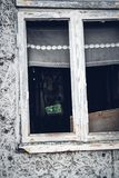 Broken window. Of an abandoned house, with naked walls no plasterwork, the devastated interior visible clean through royalty free stock photography