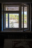 Broken window in abandoned house royalty free stock photo