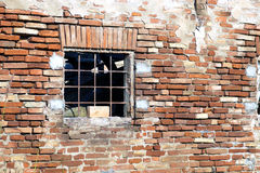 Broken window. Of an abandoned house with red brick stock photo