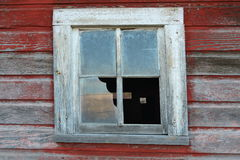 Broken window on barn Stock Photos