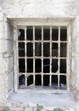 Broken window with bars Royalty Free Stock Photo