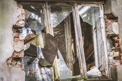 A Broken window. Broken window of a devastated house stock photos