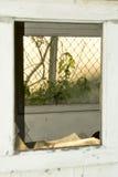 Broken window of buidling. Broken window of building of an abandon mill Stock Images