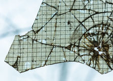 Broken window closeup Royalty Free Stock Photo