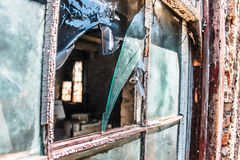 Broken Window. On a deserted factory Royalty Free Stock Images