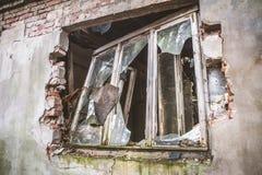 A Broken window. Broken window of a devastated house royalty free stock image