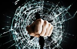 Broken window fist Stock Images