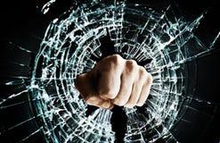 Broken window fist Stock Images