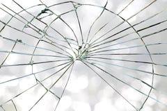 Broken window glass on a bokeh background Stock Photo