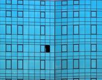 Broken window in glass facade of office building Royalty Free Stock Photo