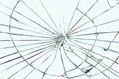 Broken window glass. On a grayish-blue background Stock Photos