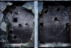 Broken window glass. Shattered glass windows with bullet holes and broken pieces Stock Photos