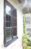 Broken Window. House with a broken window Stock Photography
