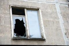 Broken window in old abandoned house stock image