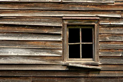 Broken Window on an Old Abandoned Wood House Royalty Free Stock Photos