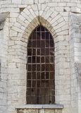 Broken window of the old church Stock Photography