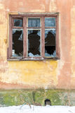 Broken window in an old house after fire.  Royalty Free Stock Images