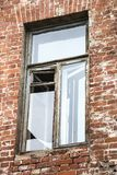 Broken window in an old house Stock Image