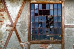 Broken window. Old broken window in red brick wall Stock Photo