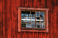 Broken window in red barn Royalty Free Stock Image