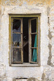 Broken window of a ruined house Royalty Free Stock Image