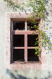 Broken window of a ruined house Royalty Free Stock Photography