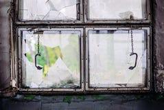 Broken window on the ship stock photo