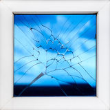 Broken window with sky reflection Stock Photos