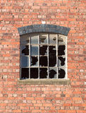 Broken window. Smashed window panes in an old building Royalty Free Stock Photos