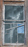 Broken Window with Stormy Sky stock photography