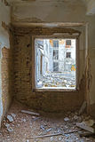 Broken window. View through the broken window of an old abandoned building Royalty Free Stock Images
