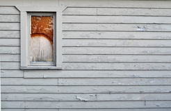 Broken window on wall with peeling paint Royalty Free Stock Photo