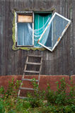 Broken window. Wall with broken window and staircase Royalty Free Stock Images