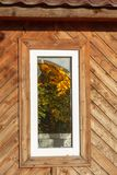 Broken window in an abandoned wooden building royalty free stock images