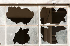 Broken windows. In an abandoned building that has been vandalized Royalty Free Stock Photos