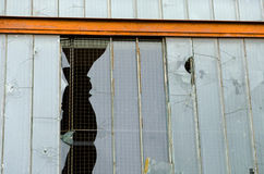 Broken windows of an abandoned building Royalty Free Stock Image