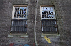 Broken Windows in Abandoned Building Royalty Free Stock Image