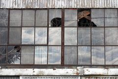 Broken windows at abandoned factory building Royalty Free Stock Image