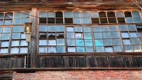 Broken windows of an abandoned house royalty free stock photo