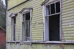 Broken windows of abandoned house Royalty Free Stock Images