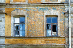 Broken windows of an abandoned house Royalty Free Stock Images